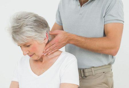 chiropractor examining patient
