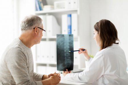 Chiropractor Reviewing X-Ray with Patient